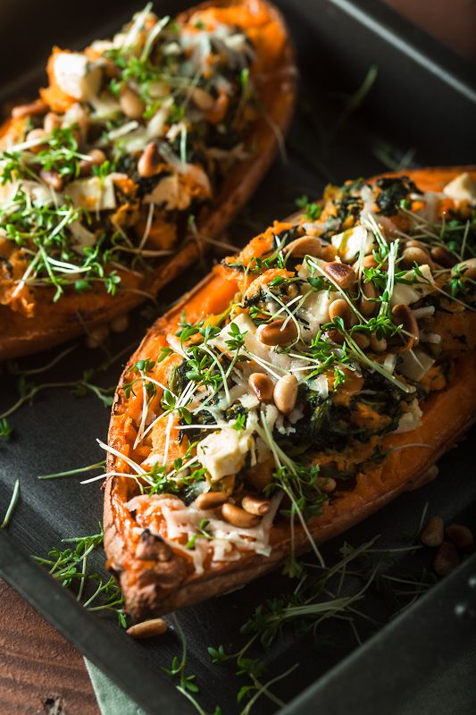 Stuffed Sweet Potato from the oven with creamy leaf spinach, tangy feta, crisp pine seeds, gratinated with parmesan. My most-loved and most-shared recipe!