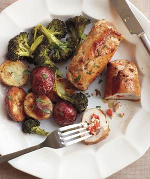 Chicken stuffed with feta and red peppers. Sides of broccoli and red potatoes