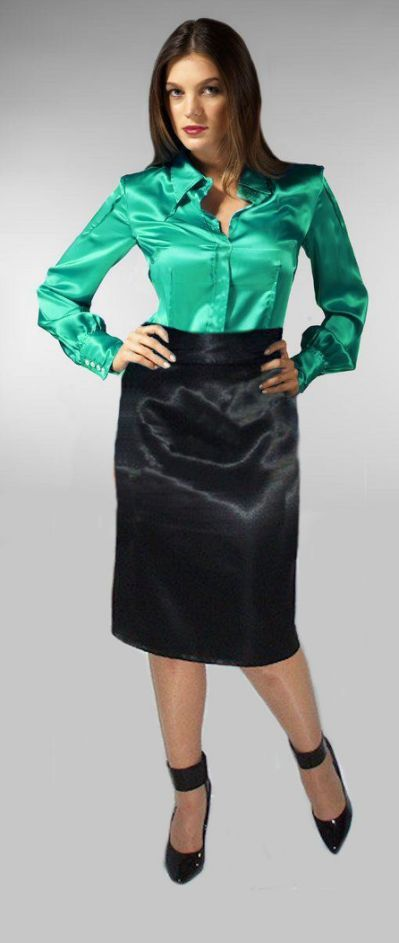 Green satin blouse and black satin skirt