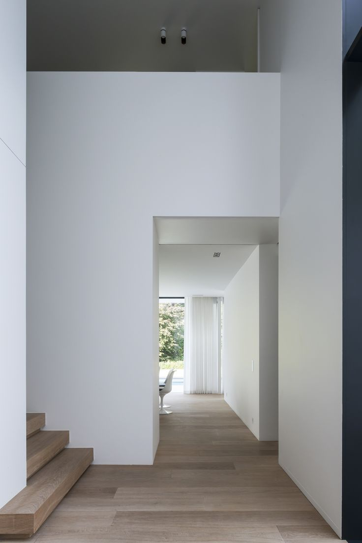 Stair Detail   White Walls   Black–Framed Glazing   Bleached Timber Flooring   Full–Height Curtains