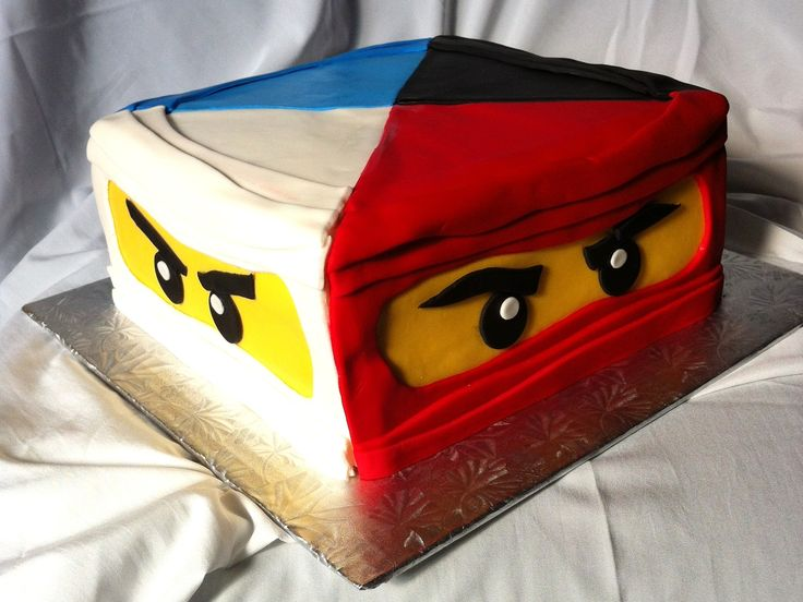 Ninjago Cake - The birthday party was at a dojo and the sensei let the birthday boy cut the cake with a sword.
