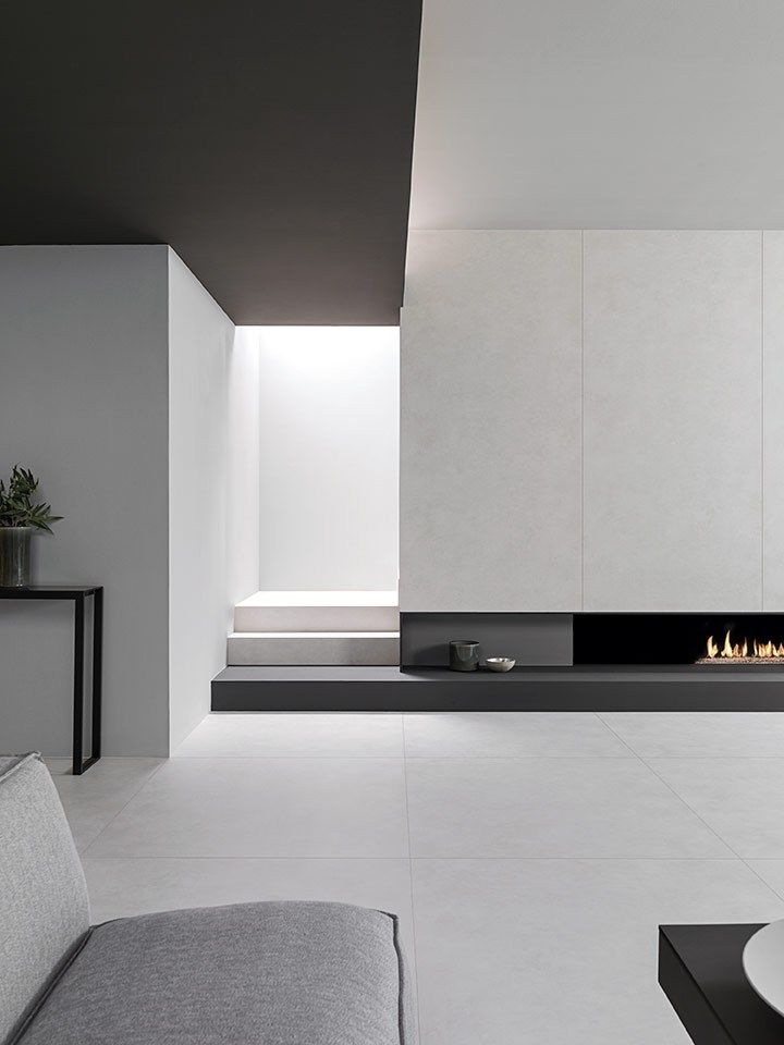 Black ceiling, white walls, black fireplace and stair ledge. Ultra-minimalism at it's finest.