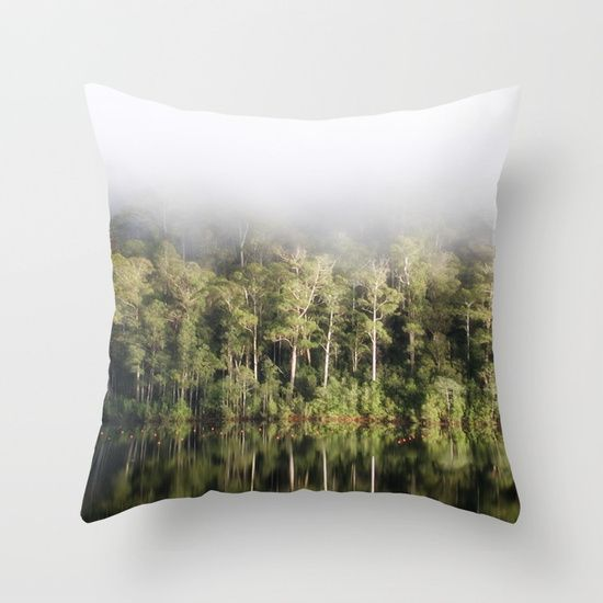 A tree lined lake on a foggy winter's Day Throw Pillow