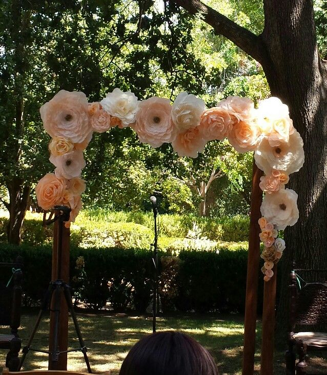 Paper flower arch for a wedding
