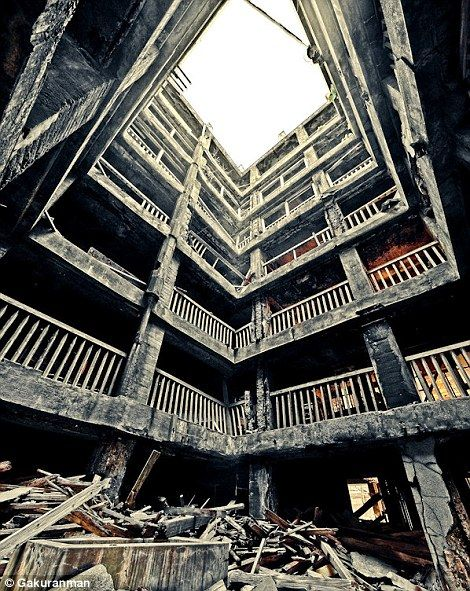 The most desolate city on Earth: Take a tour of the ghostly Battleship Island crumbling into the sea off the coast of Japan