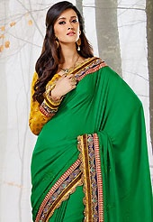 Ultimate collection of embroidered sarees with fabulous style. This green raw silk saree have beautiful embroidery patch work which is embellished with resham, zari, sequins and lace work. Fabulous designed embroidery gives you an ethnic look and increasing your beauty. Contrasting dark yellow viscose blouse is available. Slight Color variations are possible due to differing screen and photograph resolutions.