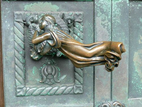 Ribe Cathedral, Denmark. Portal: Door handle in form of a girl (1904) by Anne Marie Carl-Nielsen.   Source: vmburkhardt