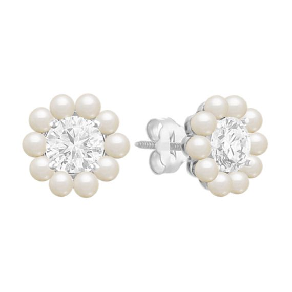 These stunning earring jackets will add luster to your solitaire earrings. Featuring 2.5-3mm cultured freshwater pearls crafted in quality 14 karat white gold, these designs will add dimension to your solitaire earrings. Simply put the post of your earrings through the center of the jacket for a stylish new look. These jackets look best with and fit up to a 2.00 carat stone or 8mm pearl in each ear. The diamond solitaire earrings pictured are not included.