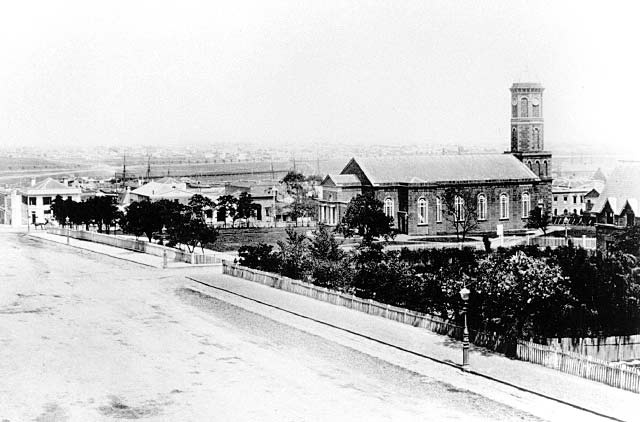 St James' Old Cathedral, Melbourne's first Anglican Cathedral, completed in 1851 near the corner of William and Collins Streets. It was dismantled and moved to West Melbourne, where it still stands, in 1913