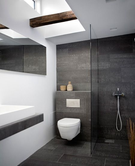 Like the idea of using big slate tiles in the bath.  Picking up from the greyish wood floors in the ret of the house
