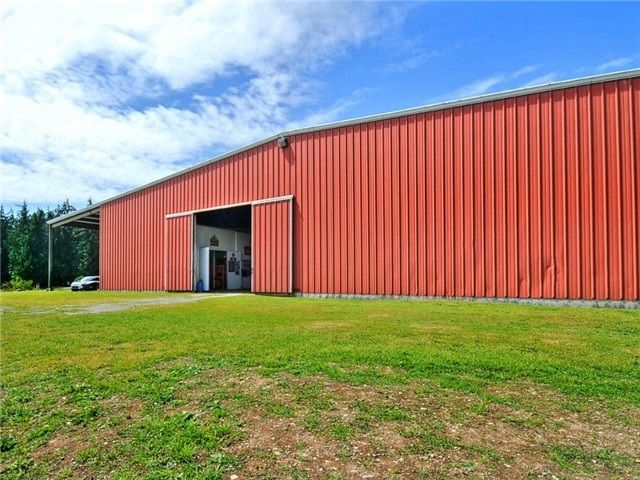 Over 30,000 sq ft Equestrian Arena. Steel frame construction. Halogen lights with skylights. Crushed river rock special flooring. Tack rooms, Treadmill, and Wash and Dry areas for easy maintenance. This barn was used for a very successful equestrian business.