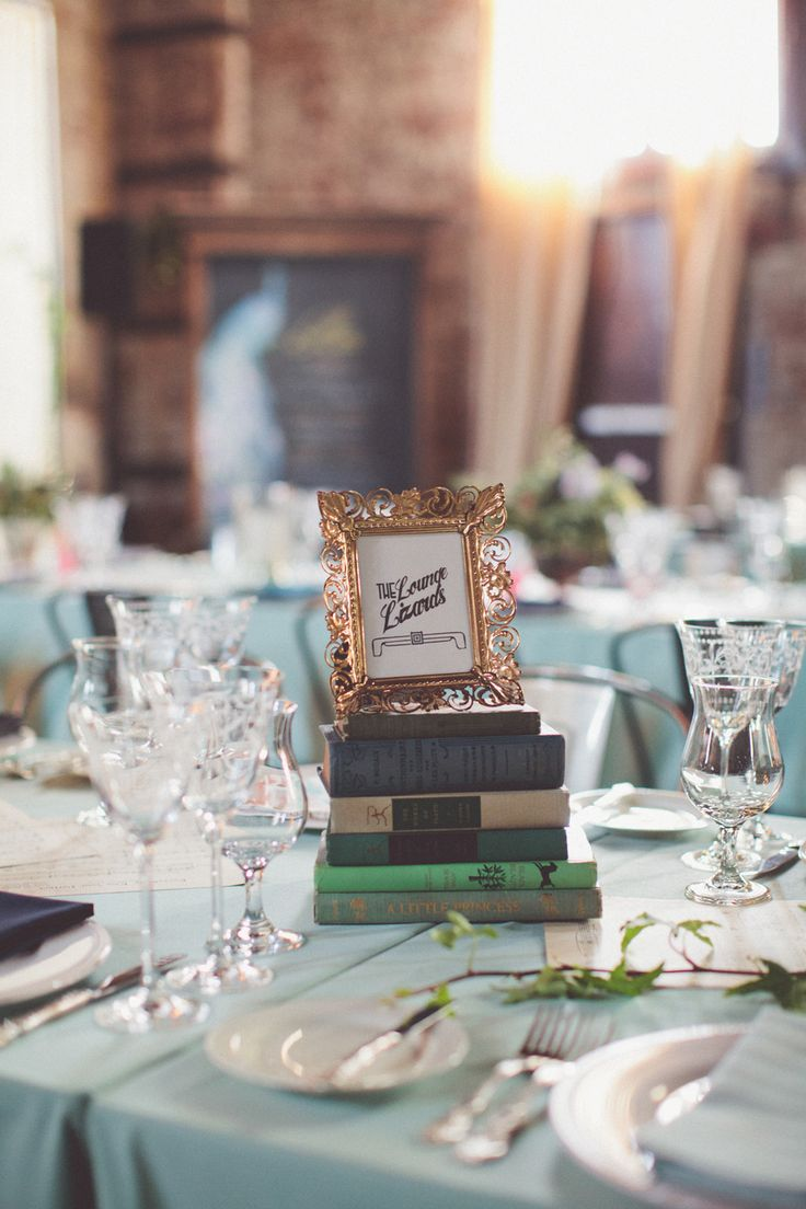 Vintage Books and Picture Frames A Deliciously Art Deco Speakeasy Inspired Wedding Soiree from Chris Spira Photography
