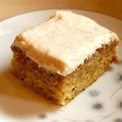 A zucchini sheet cake has an easy and different frosting made with cinnamon-flavored applesauce and cream cheese.