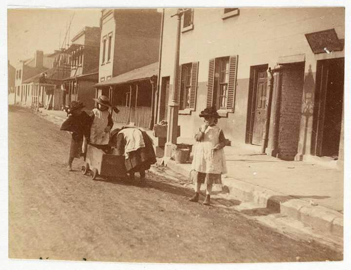 Children outside bootmaker Edward Dever's shop at 68 Cumberland S,The Rocks,Sydney in the 1880s. State Library of NSW.