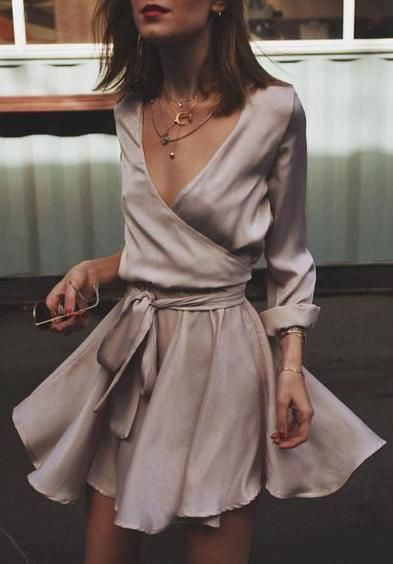 Rose colored silk wrap dress and layered necklaces