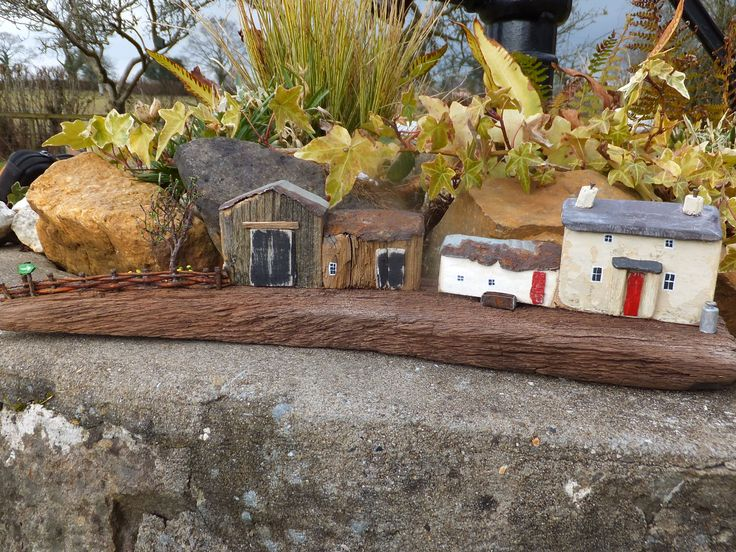 """""""Spring Walk"""" - on The Brecon Beacons Way.  Handmade in Wales on driftwood from Pendine Beach.  Made using reclaimed materials, Welsh Slate, dried heather and rusty tin."""