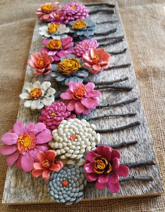 Hand made pinecone flowers on reclaimed barn wood wall