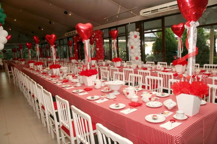 Balloon centerpieces. Use PVC pipe to add the height. Could be very inexpensive centerpiece.