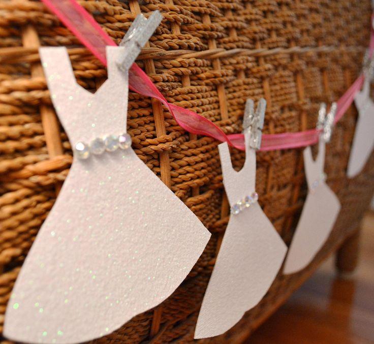 Mini Wedding Dress Garland Paper Bridal Shower Decoration Pink, Glitter, with Clothespins. $23.00, via Etsy.