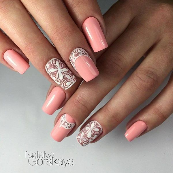 The White and Peach Floral Design. As mentioned, peach is the fire for this spring, you can try anything nude with this trendy color, like the one shown in the picture. Just coat your nails with the peach color, embellish it with studs or mix it with your creativity by combining it with white floral design.