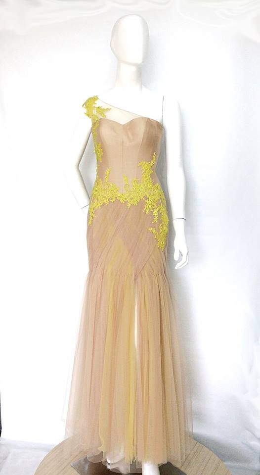 Yuni Gown. This draped tulle gown features an elegant slit and intricately embroidered and beaded French Lace. With sunshine yellow accents, the gown is simply head turning.