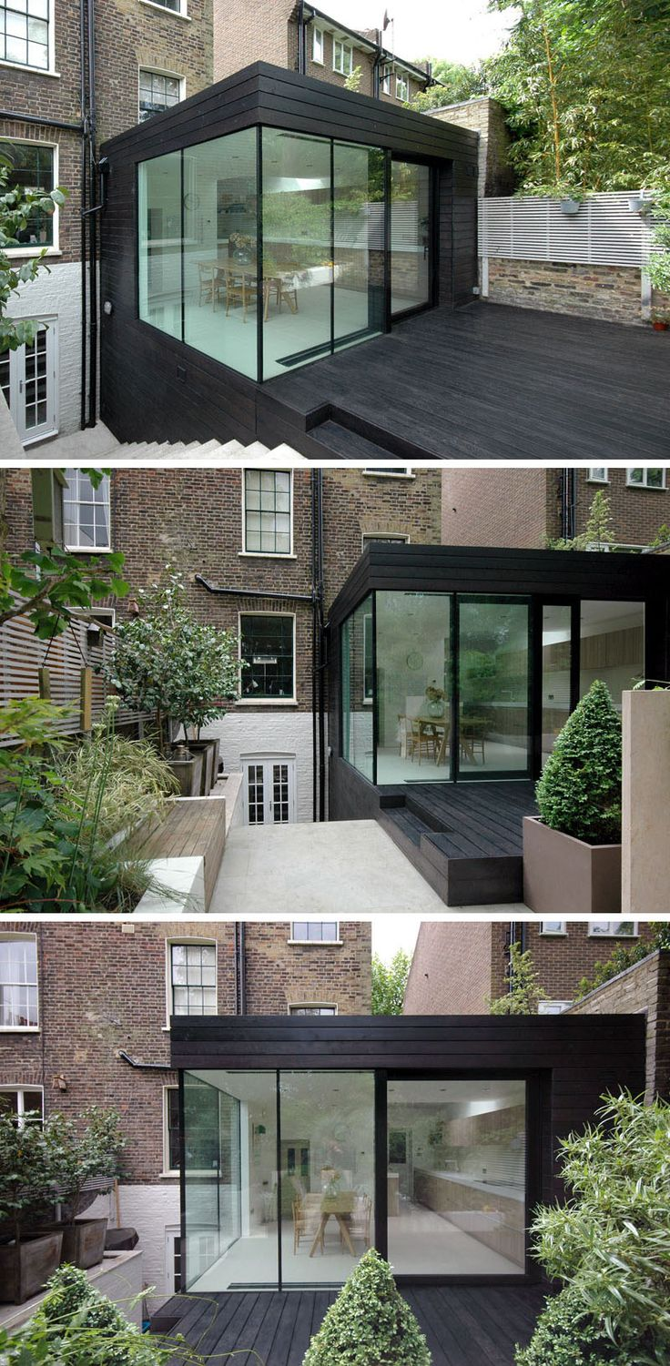 For this renovated house extension, the designers went with a two storey black box that's covered in black timber. A patio was also included to match the extension and provides a seamless look.