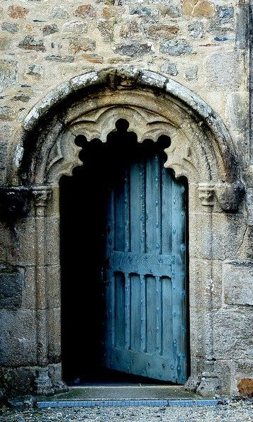 french blue door - I've seen a few of these and there's a trick; its a normal door, but the frame on the outside makes it appear on a variety of shapes. Only seen this in France on medieval buildings.