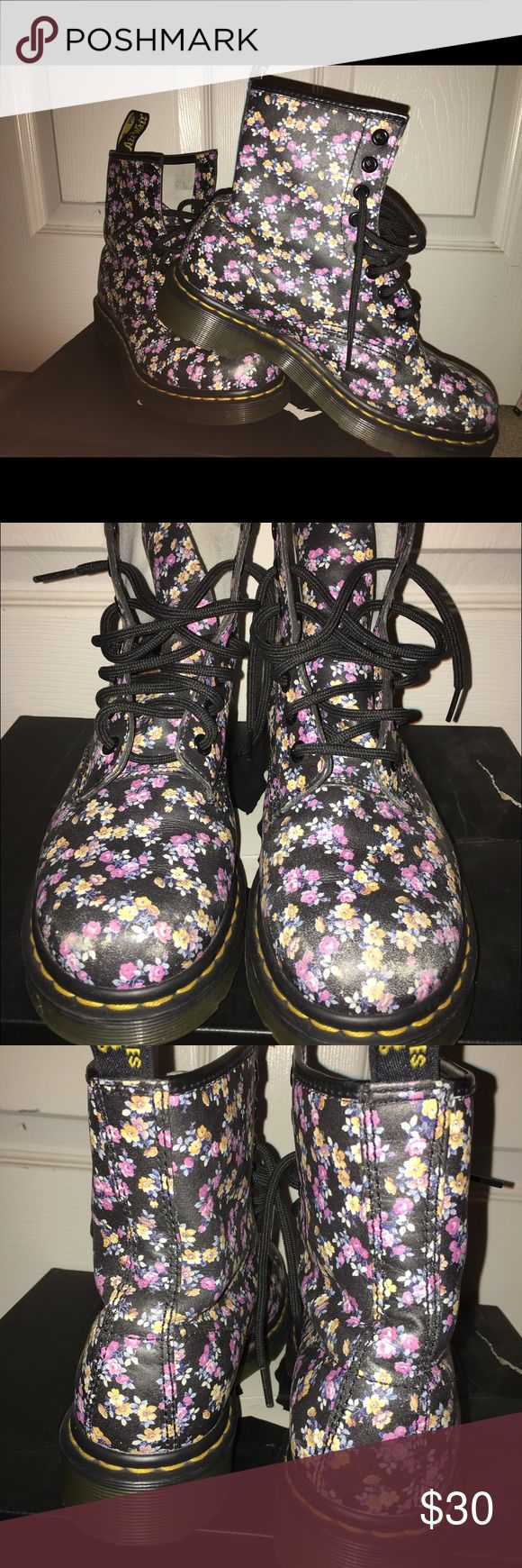 **Reserved** Dr Marten's 8 eye hole Floral sz 6 *Reserved** Doc Martens DR Marten's 8 eye hole Floral sz 6, black multi color floral pink and yellow. see last pic where shows toe area signs of wear.  Comfy as all Doc Martens are. Still in great shape. Dr. Martens Shoes Combat & Moto Boots