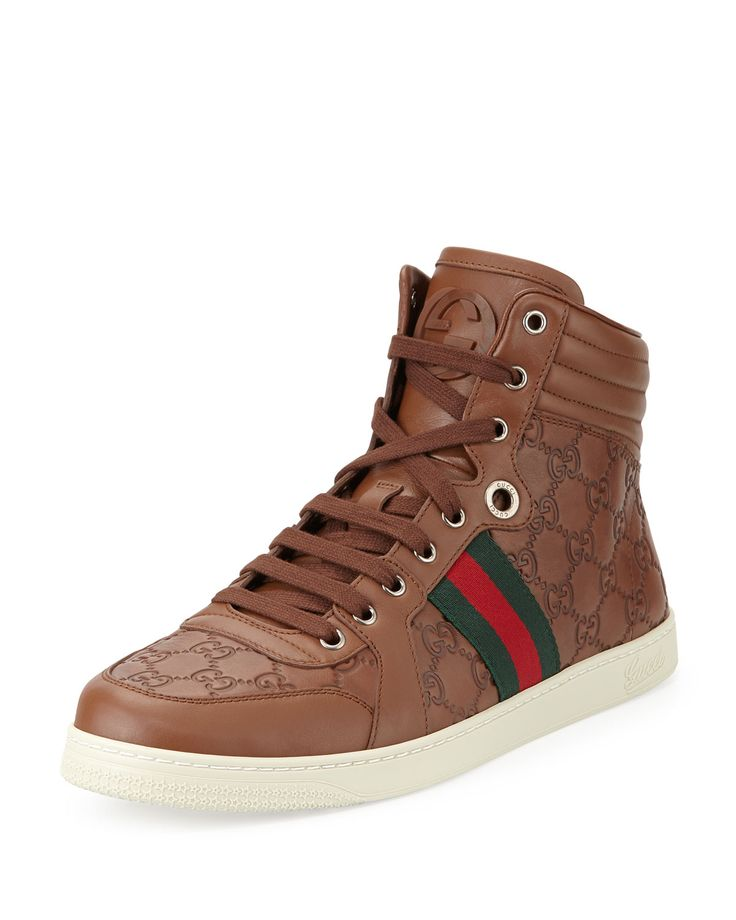 """Guccissima leather sneaker with brown leather and signature green/red/green web detail. Interlocking """"G"""" detail. 1"""" rubber sole Lace-up front. Leather lining. Made in Italy."""