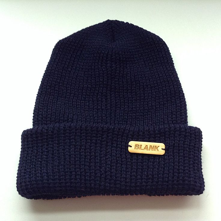 Navy cuffed toque with a small wooden hand sown label!