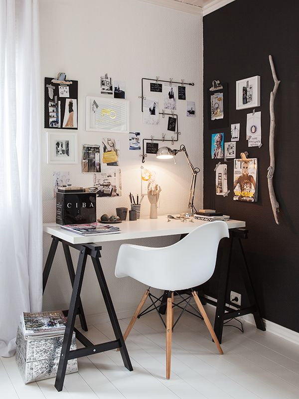 small desk. dark walls. work space.