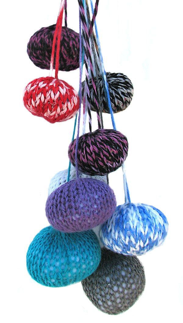 Small balls made on Addi Express knitting machine, filled with Polyester stuffing.
