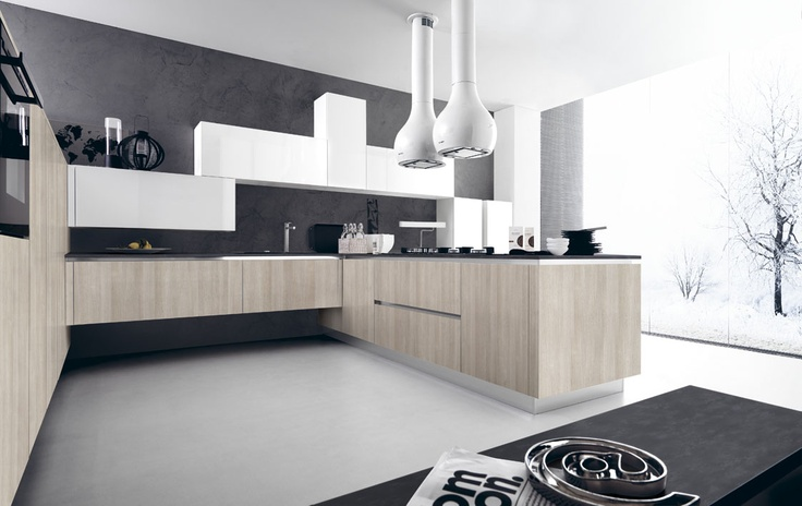 Allegra e attuale #Ariel abbina pensili sfalsati in eco-gloss bianco lucido a basi e colonne in laminato rovere provenza.  Light-hearted and modern, Ariel combines offset wall units in eco-gloss white with base and tall units in Provençe oak laminate. #Cesar #Cucine #Kitchens