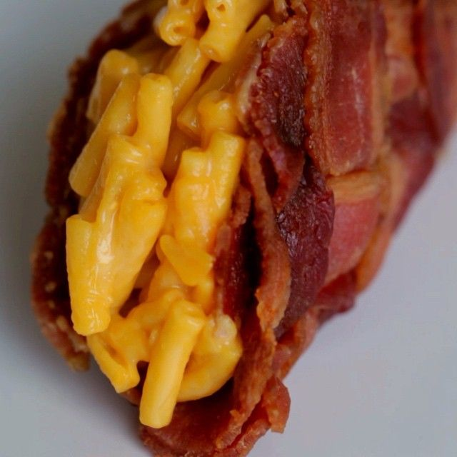 """Hi, here is a bacon mac and cheese taco.  Here is how you make it: - Make a 6x6 bacon weave using 12 total bacon strips. - Bake in a 400°F oven for 15 minutes until cooked, but not crispy, then cut it into circle. - Place 2 cups in the microwave and lay chopsticks or popsicle sticks in between to create a bridge. - Lay bacon weave circle over the """"bridge"""" so that the sides hang down. - Microwave for 2 minutes until crispy. - Fill your bacon taco shell with mac & cheese."""