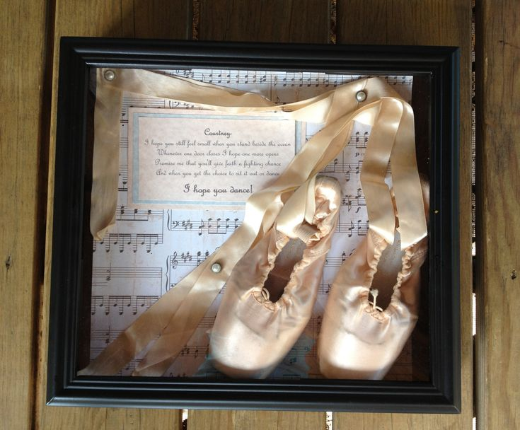 """Made this after my daughter's last dance recital. Shadow box with scrapbook paper for the background and her point shoes with the lyrics from """"I hope you dance"""""""