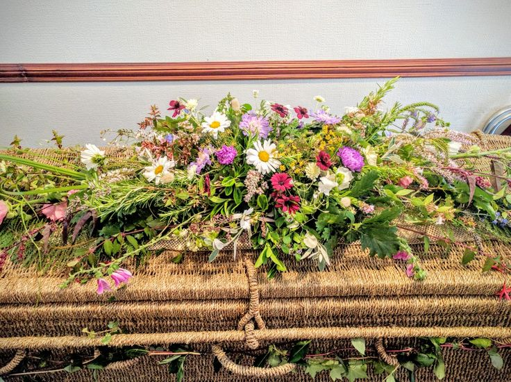 wild & rustic natural coffin spray on wicker coffin