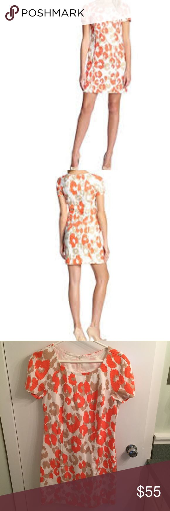 Trina Turk Merced short sleeved shift dress Trina Turk Merced dress in a coral/tan/white lynx leopard print. On seam pockets in front. 51% Cotton/49% Modal. Dry Clean Only Short sleeves. Crew neck. Made in USA. Size 6 Trina Turk Dresses