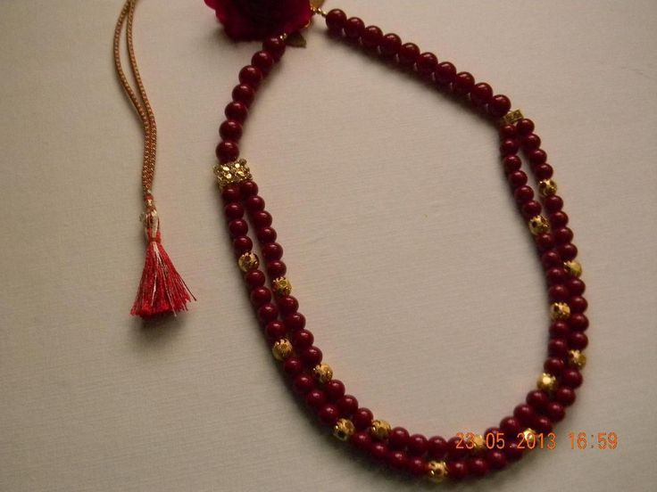 Double line red glass beads in between golden balls.  Dimensions : 22 inch in length  Material Used : glass beads and gold balls  Care Instructions : wipe after use and keep it in a air tight pouch.  Other Details : wipe after use and keep it in a air tight pouch. http://www.indiebazaar.com/product/15679/traditional-double-line-necklace
