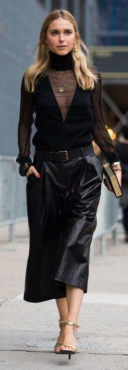 Pernille Teisbaek wears: ALTUZARRA CRISTAL CRINKLED SILK-CHIFFON BLOUSE, OLYMPIA LE-TAN BALLET BIOGRAPHIES BOOK CLUTCH, J/SLIDES by J.LITVAK EVA, McQ ALEXANDER McQUEEN LEATHER CULOTTES.