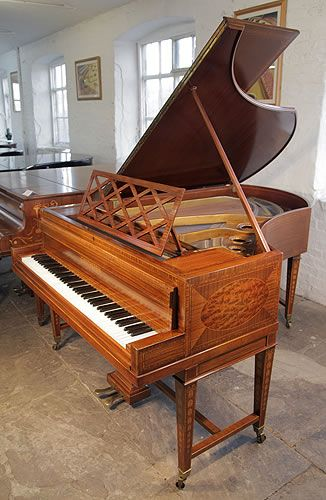 A Sheraton style, Bechstein Model V grand piano with a mahogany case and gate legs. Cabinet features walnut, satinwood and boxwood inlay at Besbrode Pianos  £10,000