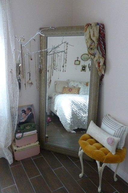 Find a branch, glitter it...hang it in front of the mirror in bedroom and use it to hang jewelery