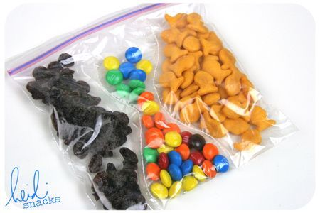 Sometimes it just makes sense to go the disposable route. Here's a simple idea that adds variety to a single sandwich bag. Using a sewing machine, stitch up a plastic sandwich bag into three sections and fill with three different snacks.