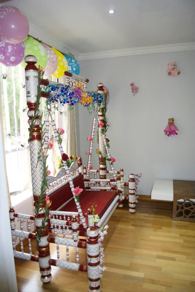 Swing decorated with orchid and rose flowers for baby shower