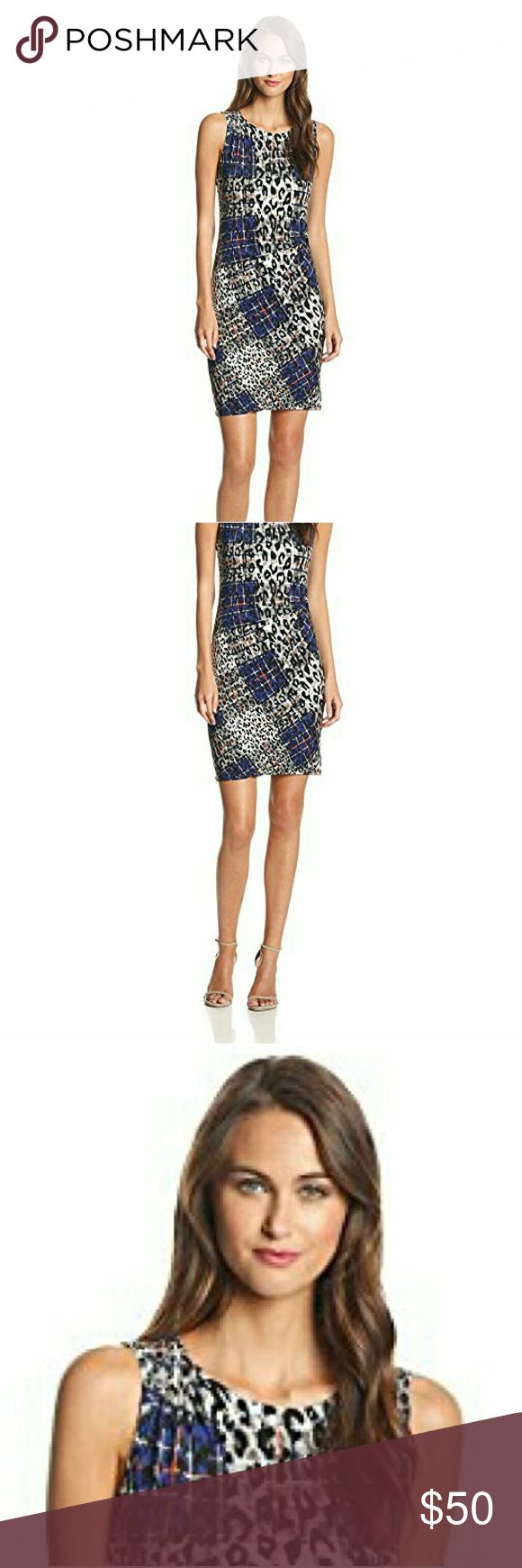 Nine West Animal Plaid Print Side Knot Dress This modern fusion  of animal print with the prim and proper Scottish plaid put a new spin on an old idea.  This daring, eye catching look is great for your next night out.  Be a proper lady ... with a wild streak. Nine West Dresses