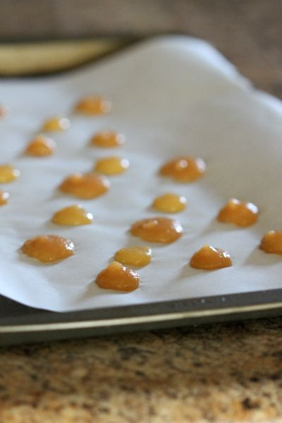 Freeze drops of applesauce on parchment paper. Peel off and it's the perfect snack for your teething toddler.