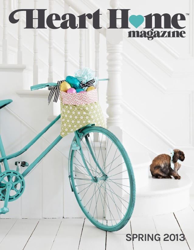 Vintage bike and Easter eggs in fabric basket. Heart Home Magazine