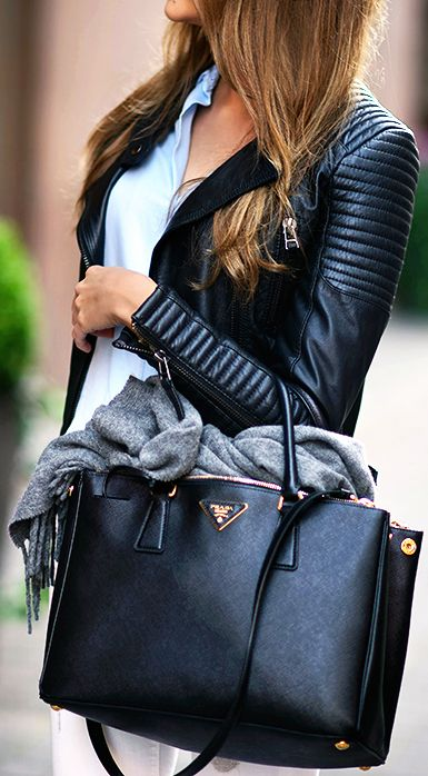 Marianna N. is wearing a leather jacket and jeans Zara and a bag from Prada