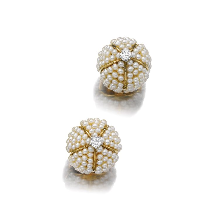 PAIR OF SEED PEARL AND DIAMOND EAR CLIPS, 'BOULE', CARTIER, 1943 Each of bombé design, set with seed pearls and circular-cut diamonds, signed Cartier Paris and numbered, French assay marks, case.
