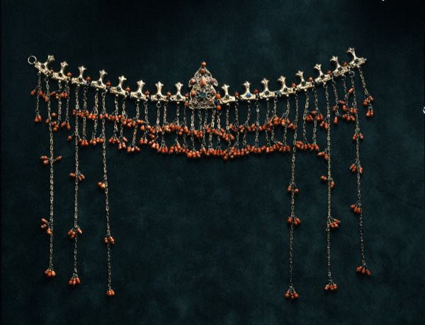 The Greek folk cultural tradition is reflected in earrings, bracelets, necklaces, pins, brooches, belts, crosses, diadems, etc.The combination of designs and arrangements of jewelry with costumes explains the variety of taste in different parts of Greece , diadem with corals from Saframboli Minor Asia