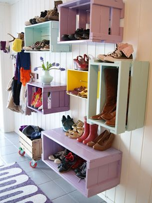 Cute way to organize shoes and purses on the bedroom wall